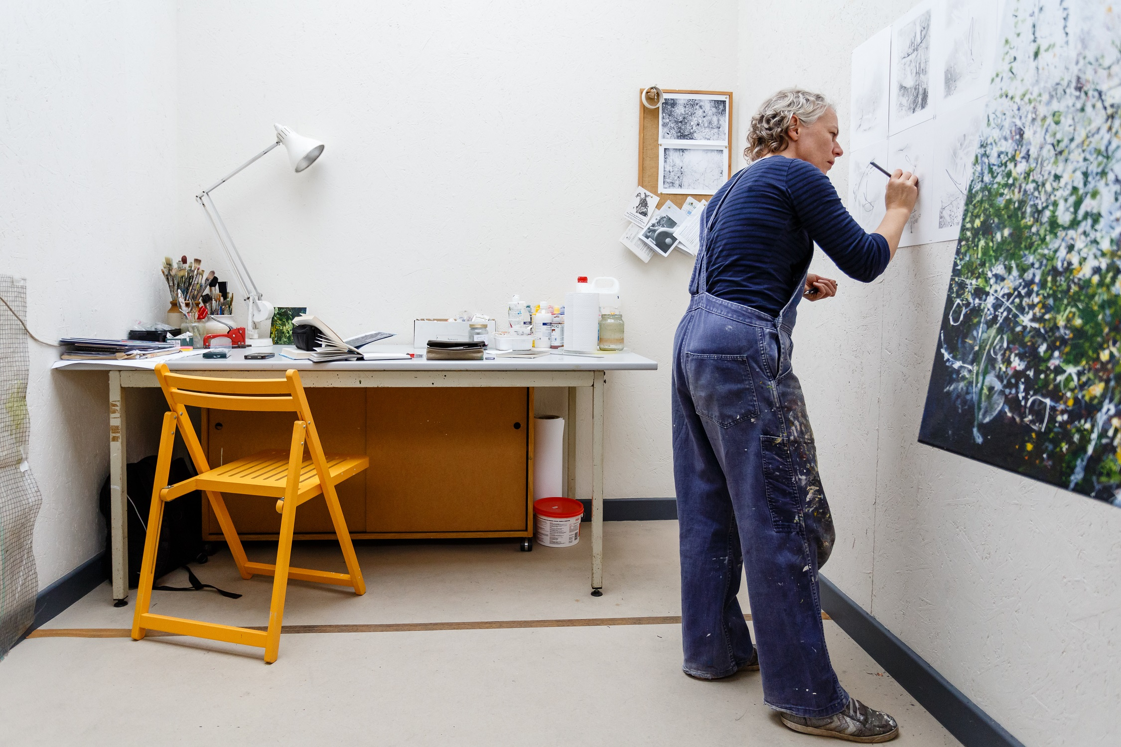 Artist Helen Thomas in her studio